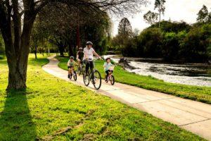 Family biking on the tumut river walkway
